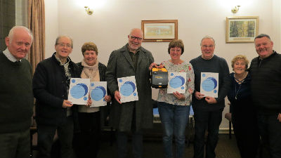 Mark King right presents certificates and our defibrillator