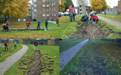 MAD volunteers planting bulbs on the Spitals Cross estate in Edenbridge