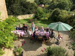 Cakes  Company at tea on the terrace