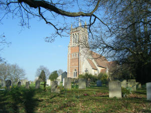 St Michael & St Mary Magdalene Church viewed from the churchyard with blue sky in the background