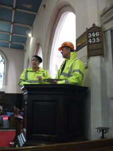 Two workmen observe the events of Easter