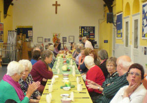 Members of the congregation chatting before the Harvest lunch 2014