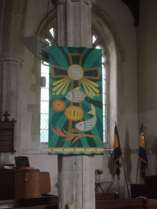 A banner in Elsworth Church