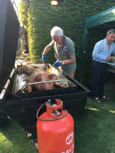 John cooking the Hog