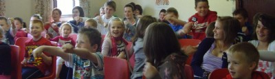 Happy children learning Bible stories with Garry Tutty