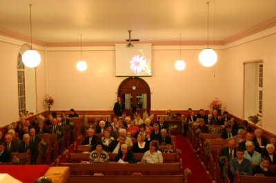 Church filling up for Harvest Thanksgiving Service