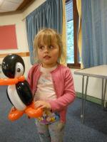 girl holding model peguin