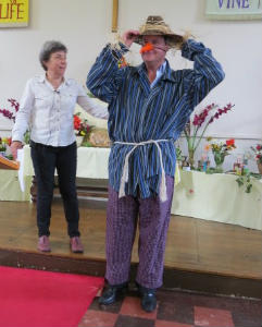 Craig as a scarecrow with carole