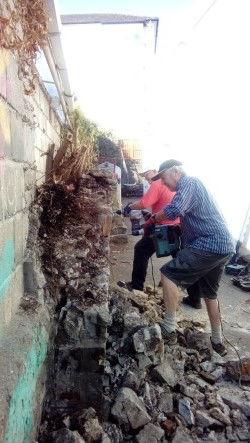 John and Doug demolishing the wall