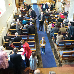 People gathering for worship in Barham