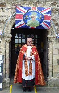 Revd Canon David Frost before the service