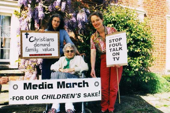 Three ladies protesting for media march