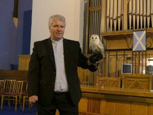 barn owl on ministers arm
