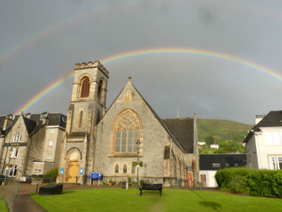 rainbow over church