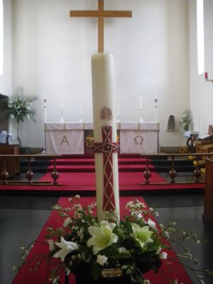 Easter lilies, candle  altar, cross 2010