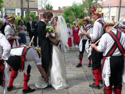 Wedding  Morris dancers outside church