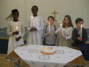 Communion b4 confirmation candidates with candle cake