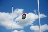 rugby ball in goalposts