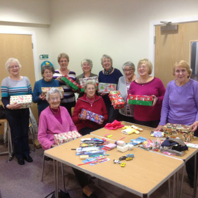 Lunch Club members pack shoeboxes for Operation Christmas Child