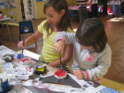 Children painting at Holiday Club
