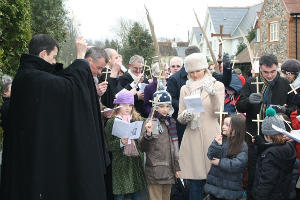 donkey leads the procession from Holy Trinity school