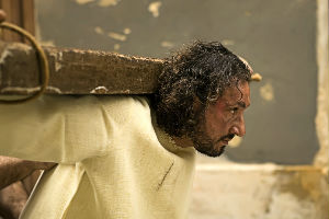 jesus holding cross