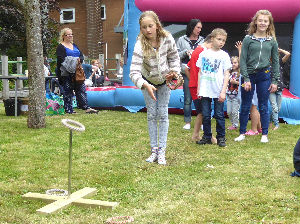 girl getting a prize with quoits