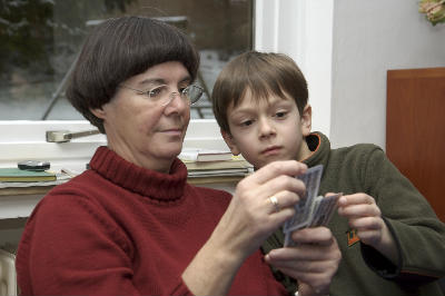 Grandma playing Christian Card games with boy
