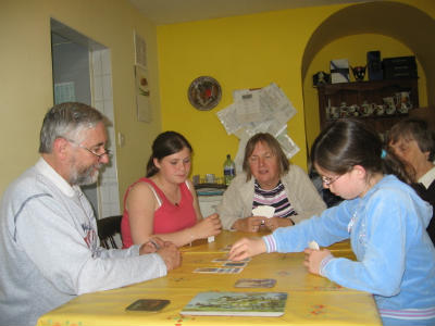 family playing Bible card games