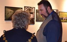 Guy speaks with Mayor