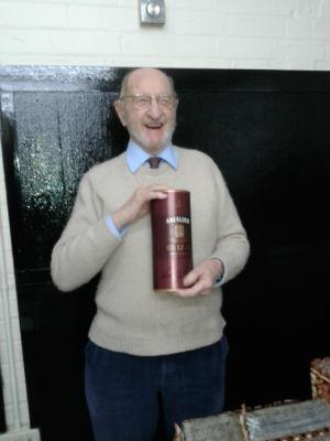 Ken proudly holding a bottle