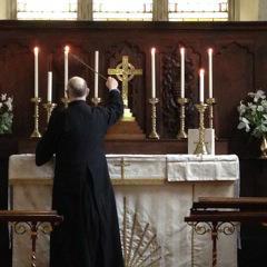 Ken lighting candles
