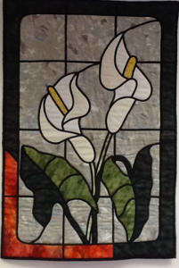 Quilt showing lilies growing from fire