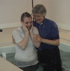 A very happy young lady being baptised