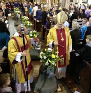 Bishop Richard blessing the bells