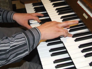 playing hands and keyboard