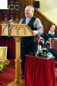 Our Pastor following change to 2011 style