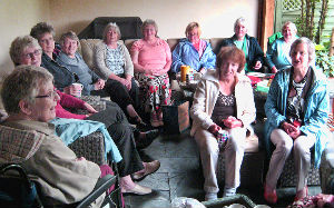 Group enjoying tea and cake