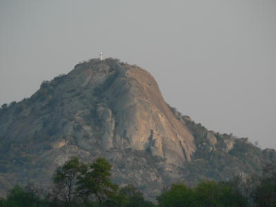 the prominent cross on Mt Inungu