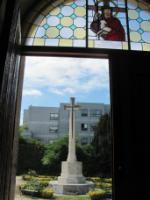 Church door  porch and war memorial