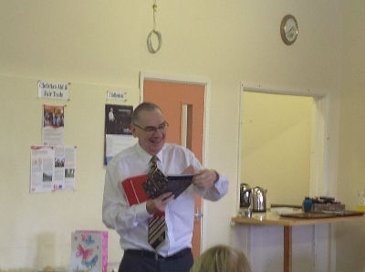 Richard opens gift from the church