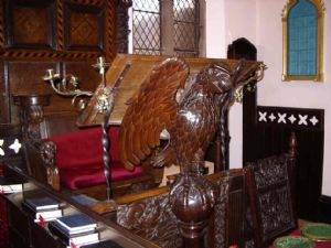 Carved eagle supporting the Vicars desk.