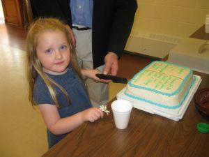 Sarah got to cut the cake