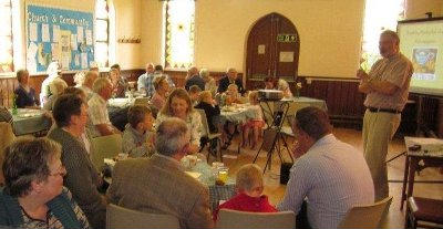 Photo of the congrgation at the cafe church in the Stewkley school room
