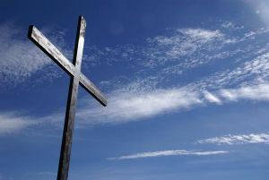Cross under blue sky