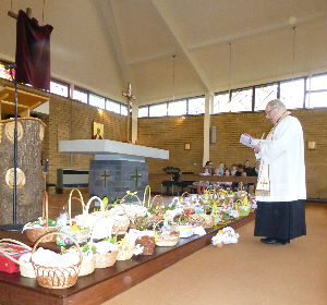 Fr Adrian in front of baskets