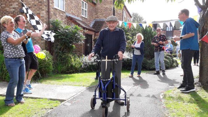 Ken completing his walk