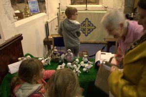 Families collecting Posada figures