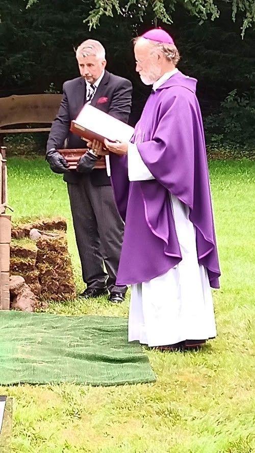 Bishop at cookies grave