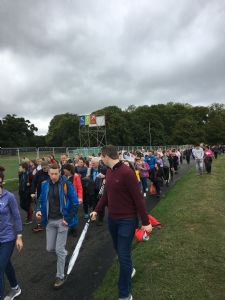 Despite wet weather, people make their way to Final Mass